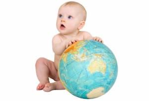 IVF Mexico Baby holding a globe